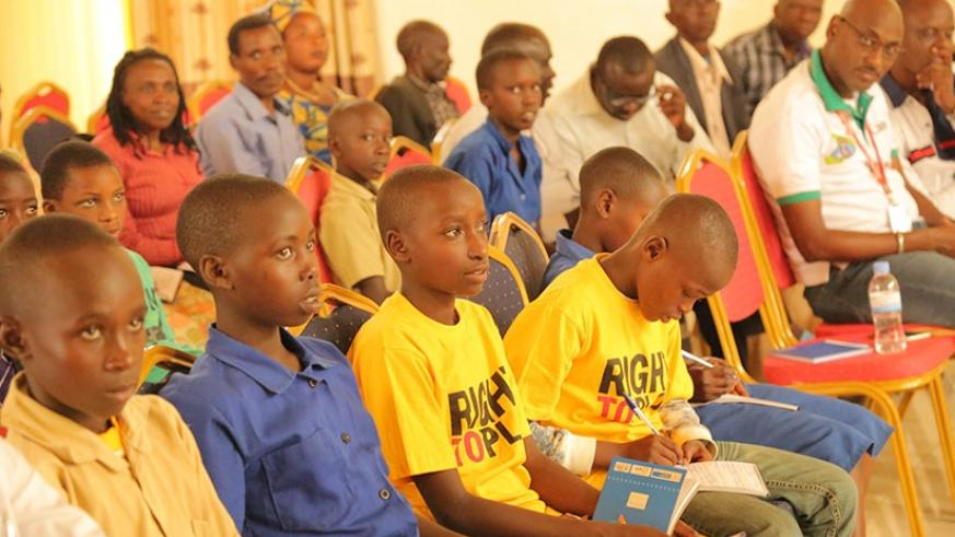 Children and their parents during the meeting. Olivier Muragijimana