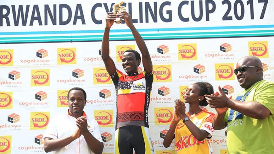 Patrick Byukusenge holds his trophy aloft as the 2017 Rwanda Cycling Cup champion on Saturday. Sam Ngendahimana.