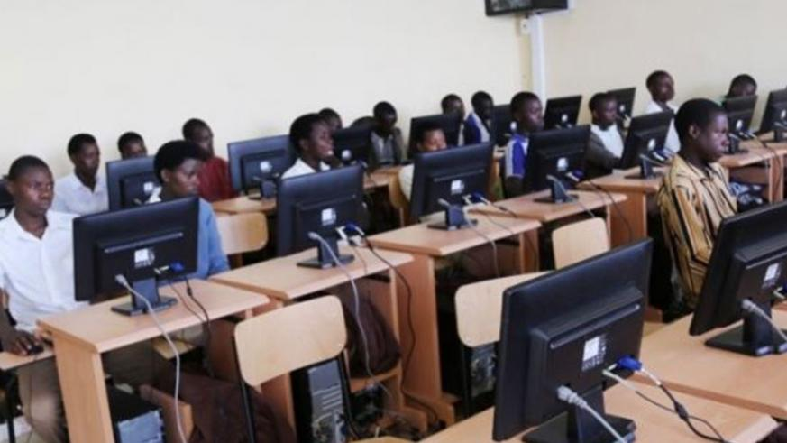Students using computers in a Community Knowledge Centre. File.