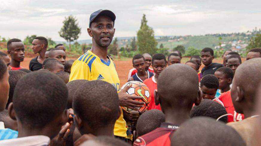 Murangwa talks to a group of young Rwandan football players during a training session last year. The former Rayon Sports' goalkeeper says he believes in the power and influence of ....