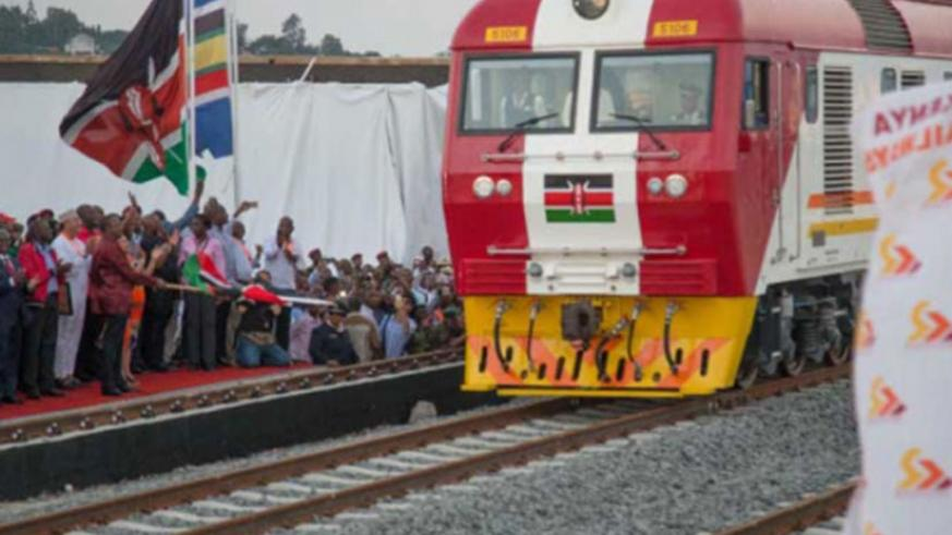 President Kenyatta flagging off the standard gauge railway train last year. (Net photo)