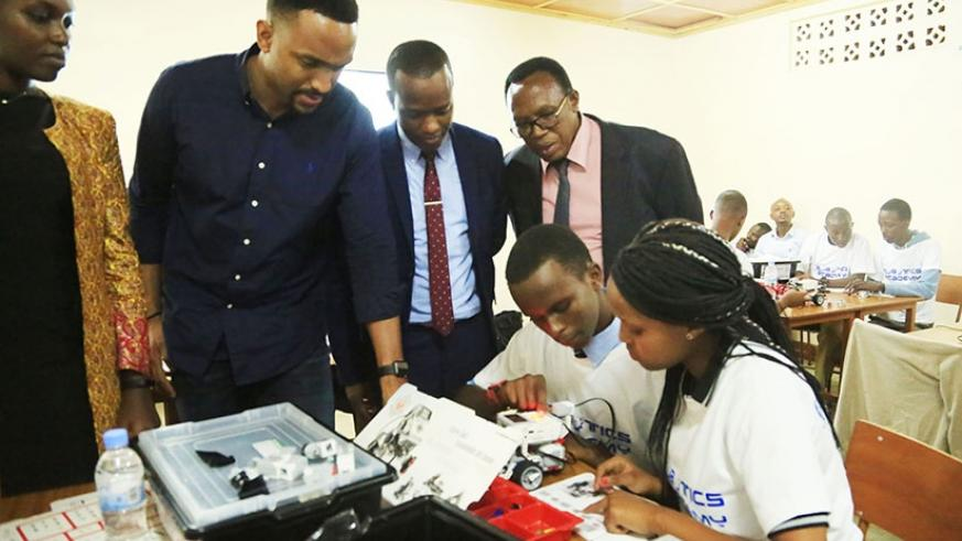Officials look on as students go about their exercise during the launch of  the inaugural Robotics Camp Rwanda in Kigali yesterday. (Photos by Sam Ngendahimana)