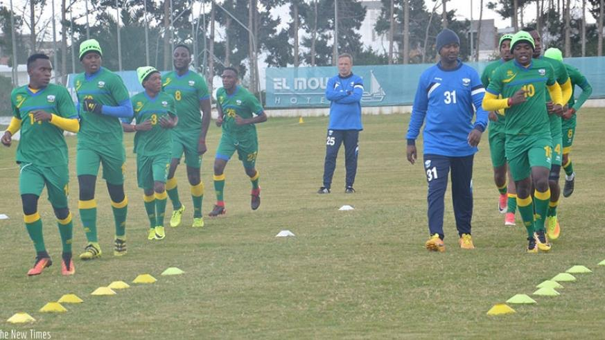 Amavubi assistant coach Mashami taking the players through their paces in Tunisia on Wednesday as head coach Hey looks on in the background. Courtesy
