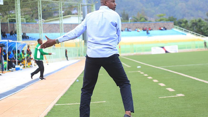 Kiyovu Sports head coach Andre Casa Mbungo gives instructions to players in the recent match at Kigali. / Sam Ngendahimana