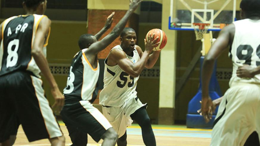 Patriots' Power Forward Junior Kasongo, on the ball, scored a game high 16 points to lead Patriots to a 65-52 win over  APR. / S. Ngendahimana