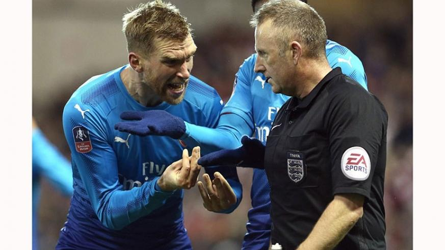 Mertesacker looks furious as he appeals to Jonathan Moss to rule out Nottingham Forest's second penalty for a double kick. (Net photo)