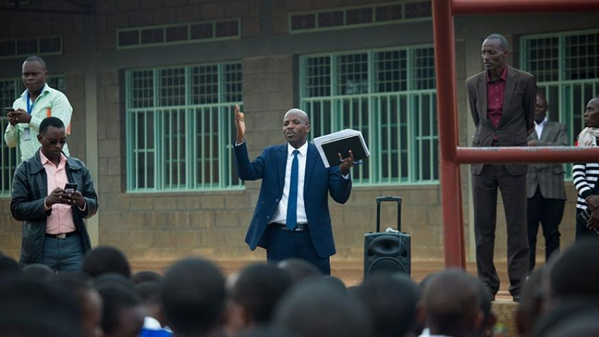 Michael Tusiime, the deputy director in charge of examinations and accreditation at Rwanda Education Board speaks to PLE candidates before the start of exams last November. (File)
