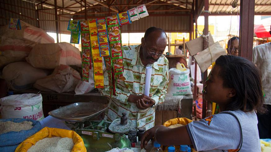 MP Emmanuel Mudidi speaks to a vendor at Gahanga market in Kicukiro during a past countrywide tour by the lawmakers. / File