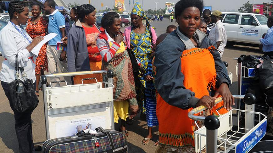 Some Rwandan returnees from Malawi on arrival at Kigali International Airport in August 2013. Government says over 84,000 former Rwandan refugees have returned home since 2009 and ....