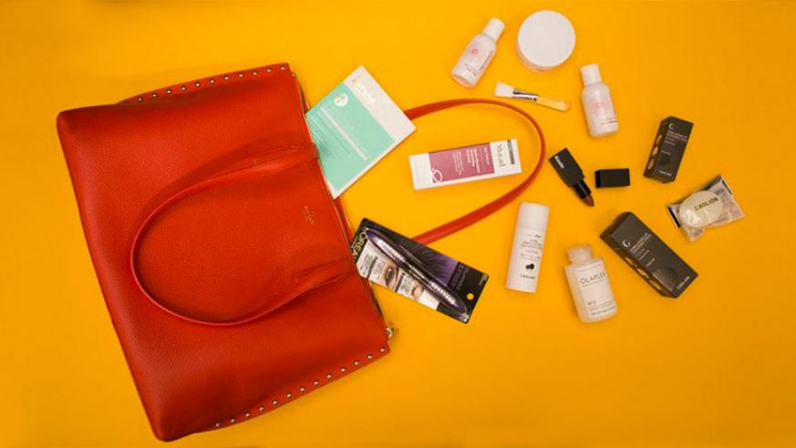 Kate Spade's Made in Rwanda handcrafted tote bags filled with makeup and beauty products. Courtesy photos.