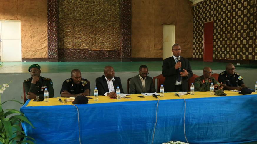 State Minister in the Ministry of Health, Dr. Patrick Ndimubanzi addressing local leaders, elders, religious leaders and teachers on fighting illicit drugs.