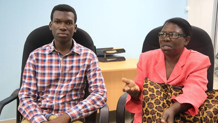 Mbonyumugara and his mother at The New Times Publications offices on Wednesday. Sam Ngendahimana.