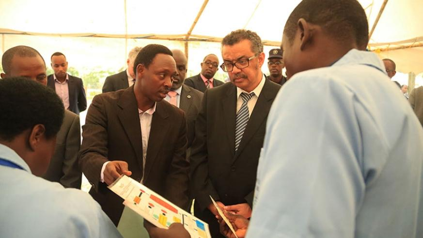 Community Health workers in Bugesera show Dr Tedros Adhanom Ghebreyesus (in glasses) how they treat patients in their villages yesterday. Sam Ngendahimana.