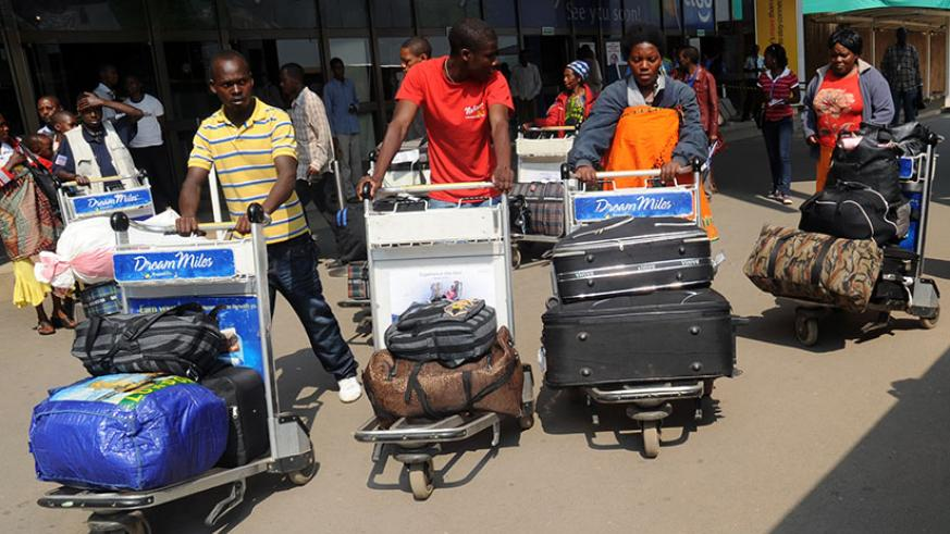 Rwandan returnees from Malawi on arrival at Kigali International Airport in August 2013. File.
