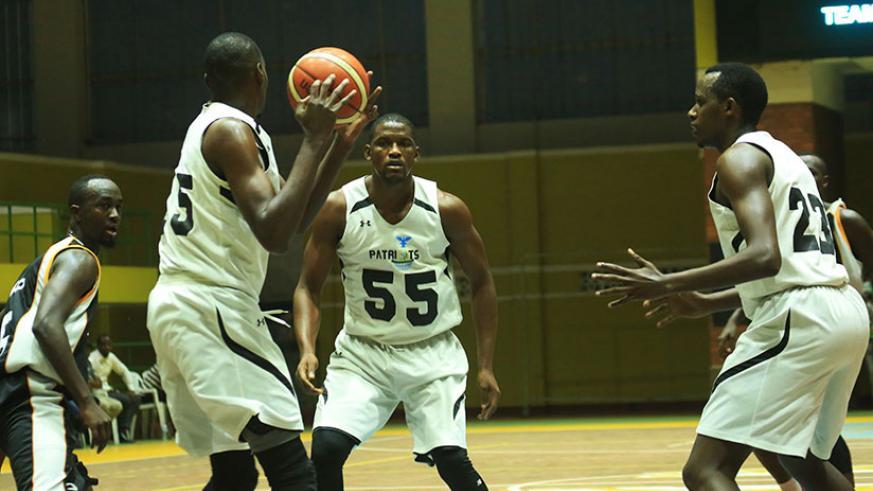 Patriots' new forward Micheal Makiadi looks to pass the ball to Junior Kasongo (#55) during the last league game against APR. / Sam Ngendahimana
