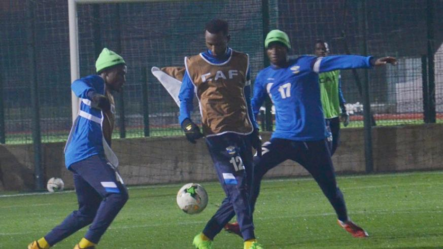 Amavubi vice-captain Bizimana, left, seen here in training on Friday night, has declared that they are in Morocco to compete with the aim of getting out of Group C. / Courtesy