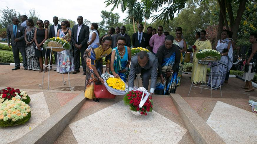 Survivors lay a wreath on the grave of a victim of the 1994 Genocide against the Tutsi at a past commemoration event. / Nadege Imbabazi