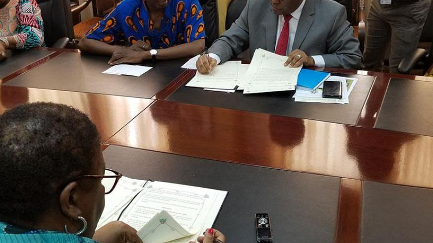 Dr. Belay Begashaw, Director General of the SDGC/A and Ambassador Marjon V. Kamara, Liberian Minister of Foreign Affairs sign the Host Country Agreement that will facilitate the es....