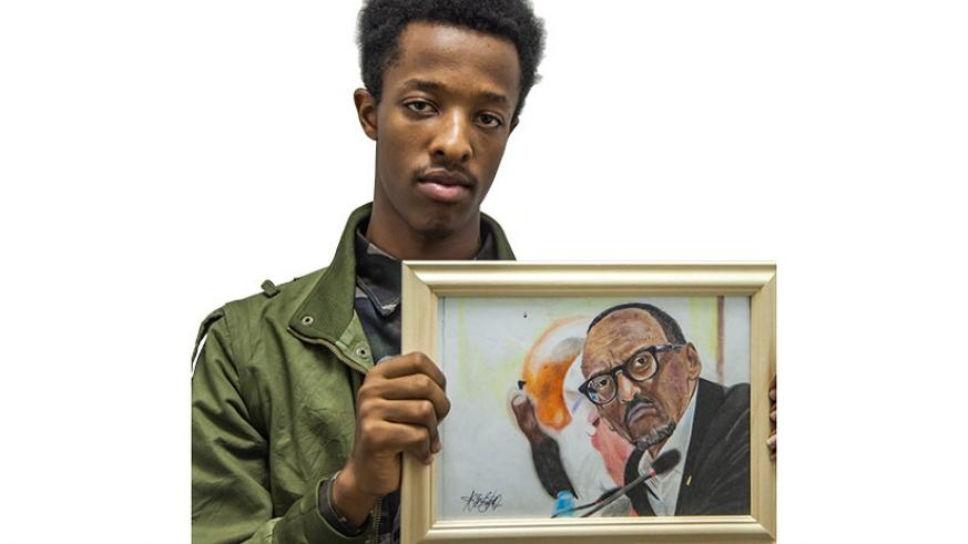 Peter displays a portrait of President Paul Kagame.