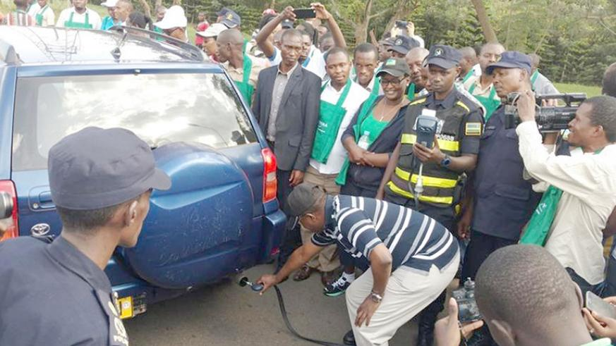 Vincent Biruta, Minister for Environment, during the exercise of testing emissions from car last year. File