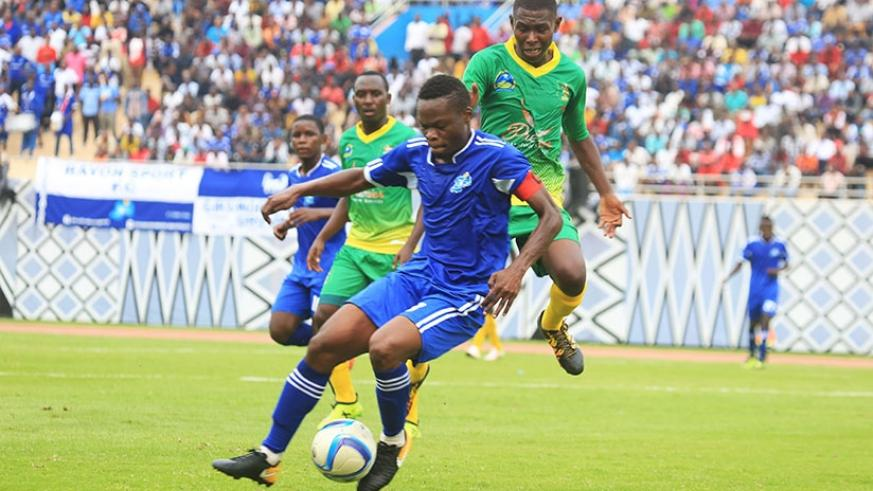 Rayons Sports skipper Pierrot Kwizera vies for the ball with AS Kigali's Benedata during the 0-0 draw in Heroes Cup at Amahoro National Stadium.  / Sam Ngendahimana.