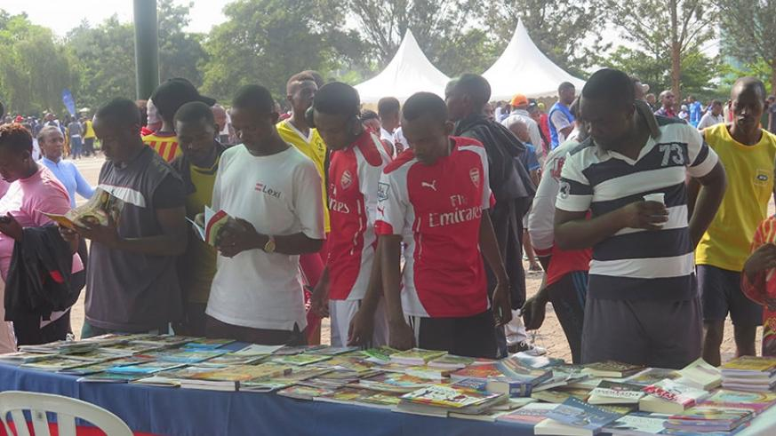 People at the book exhibition after the Car Free Day Sports gathering in Kimihurura on Sunday. Eddie Nsabimana.
