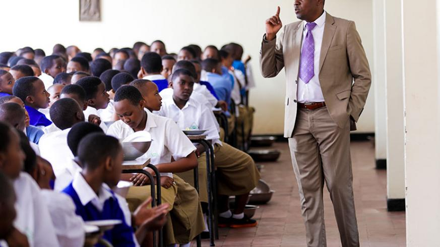 The State Minister for Primary and Secondary Education, Isaac Munyakazi, speaks to students of Lycee Notre Dame De Citeaux on the opening day of the new academic year yesterday. Du....