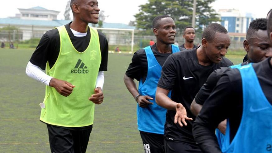 APR fans will be waiting anxiously to see what new signings Jean Baptiste Mugiraneza (L) and Jean Claude Iranzi (C) have to offer to the military side. / Courtesy