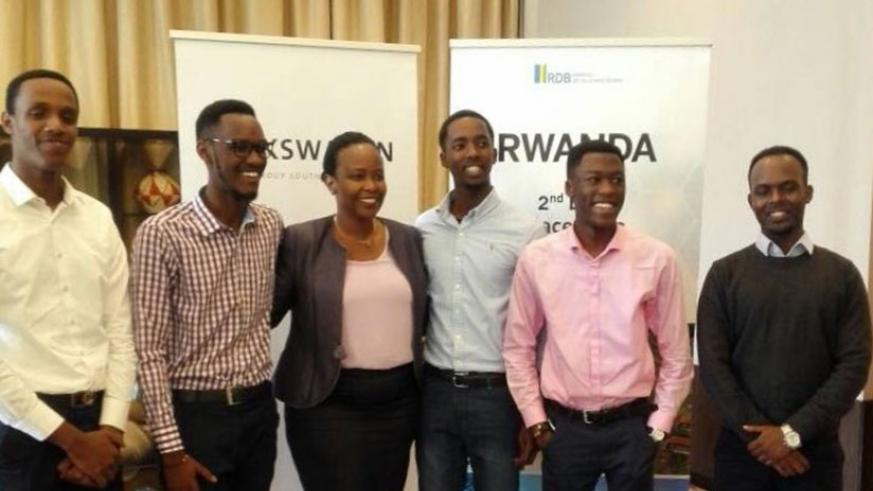 RDB CEO Clare Akamanzi poses in a group photo with members of Awesomity Lab. Courtesy.