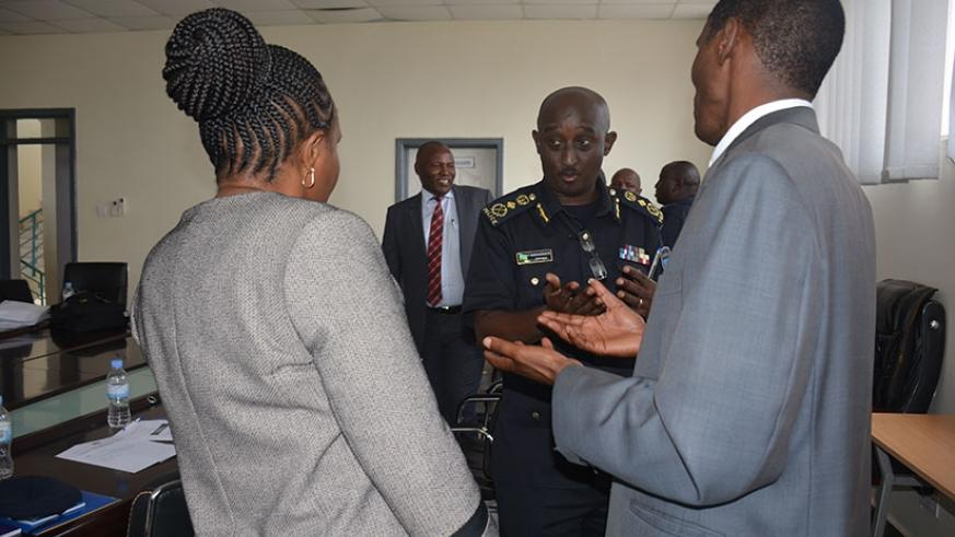 Prof. Kerosi and Muchemi chat with the Commissioner of Police, Felix Namuhoranye after agreeing to train the police in Law Enforcement and Justice Administration.
