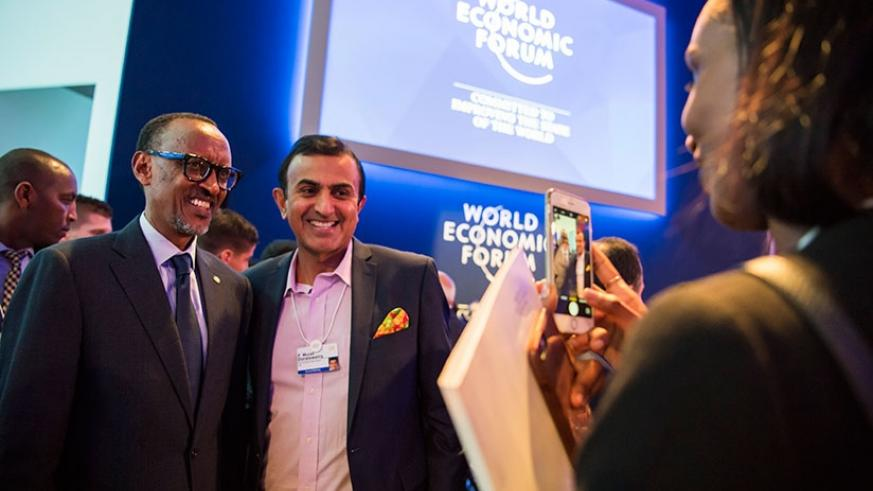 President Kagame with a delegate at the 48th World Economic Forum meeting in Davos, Switzerland yesterday. Village Urugwiro.