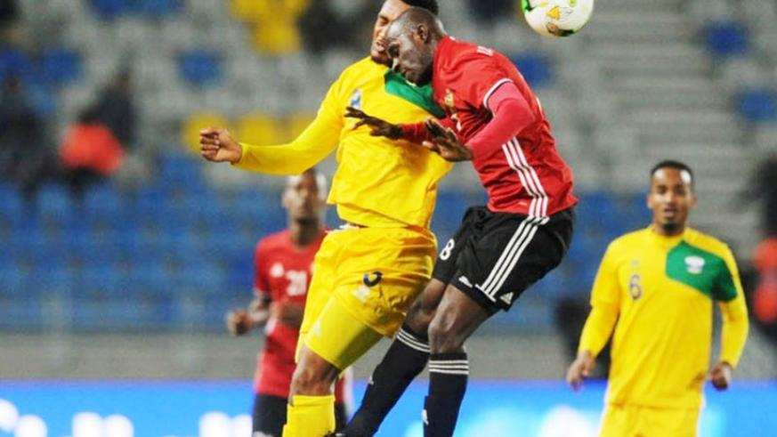 Rwanda midfielder Ally Niyonzima challenges Abdulrahman Ramadhan Khalleefah of Libya during the second half. Amavubi lost 1-0 to finish third in Group C and bow out of the tourname....