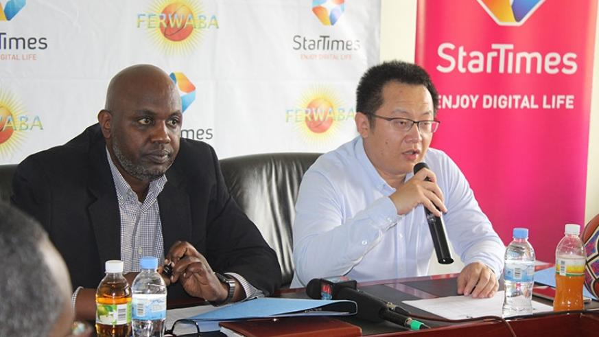 Desire Mugwiza signed on behalf of FERWABA while Star Times was represented by its Chief Executive Officer, Jess Yuchang. Courtesy.