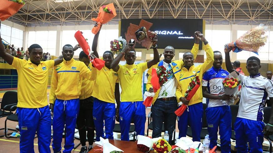 Team Rwanda celebrate their success shortly after jetting back home on Tuesday. File.