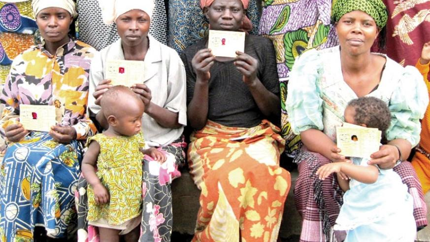 Mothers with Mutuelle cards await for medical service at a health facility. File.