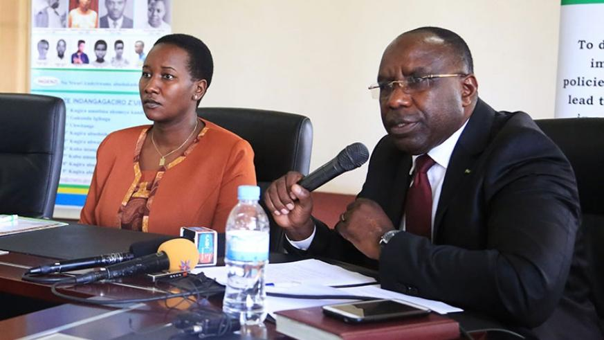 The Chairperson, Chancellery for Heroes, National Orders and Decorations of Honour, Pierre Damien Habumuremyi addresses media as Minister Julienne Uwacu looks on yesterday. Sam Ngendahimana.