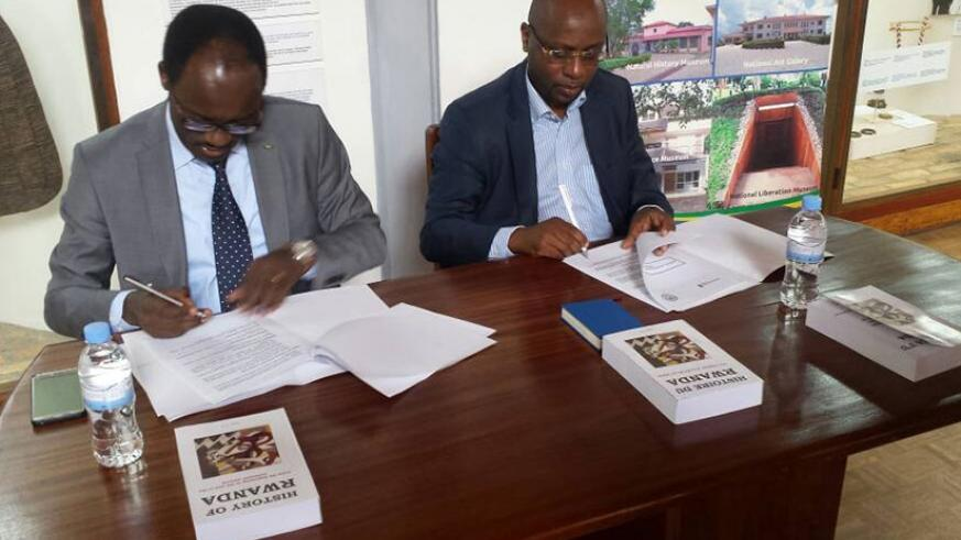 Ndayisaba (L) and Masozera sign the deal in Huye District on Thursday. (Courtesy)