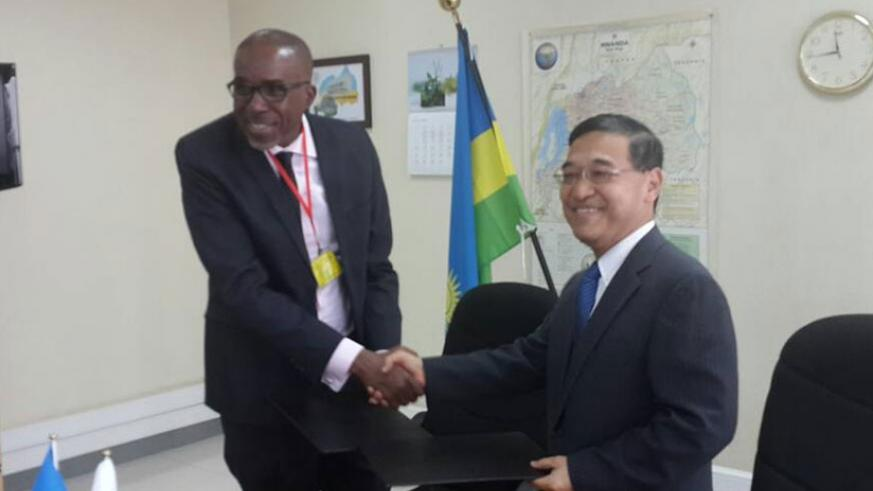 The Japanese envoy, Takayuki Miyashita, and the Rwanda Karate Federation president, Theogene Uwayo, signed the deal on Friday. (James Karuhanga)