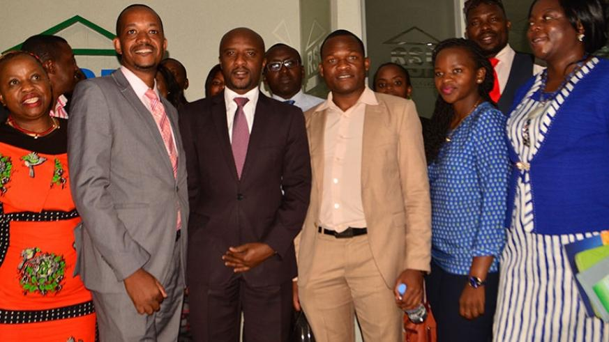 Rwabukumba (third left) pose for a group photo with visiting Zimbabwean business delegation. The Zimbabweans expressed interest to invest on local bourse. / Frederic Byumvuhore.