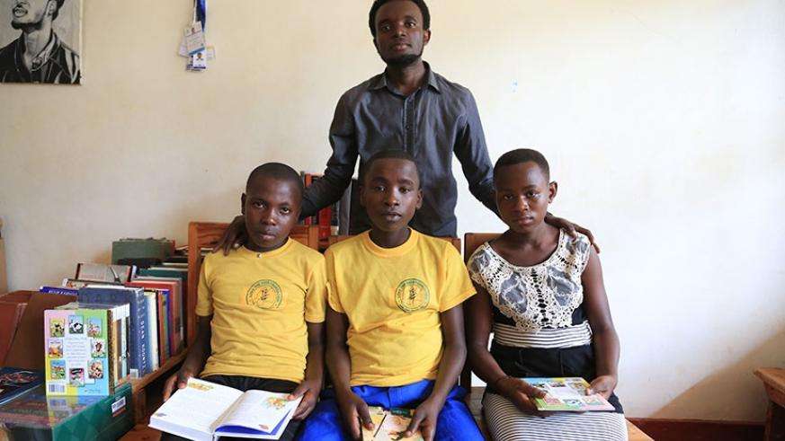 Some of the kids pose for a photo with Muhire., the founder. /Photos by Donah Mbabazi