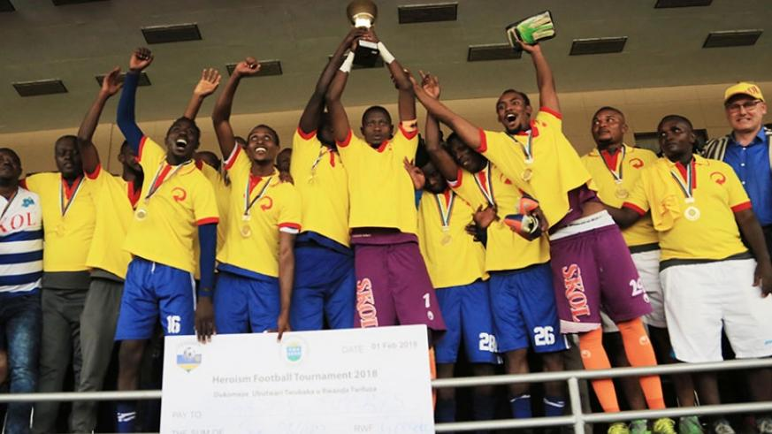 Rayon Sports players celebrate the Heroes Cup title winning despite losing 2-1 to APR. / Sam Ngendahimana
