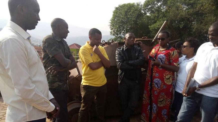 Some of the members of RYVCP lean against the armored vehicle that was used by ex-FAR during the 1994 Genocide against the Tutsi to prevent Tutsi from accessing the Parliamentary B....