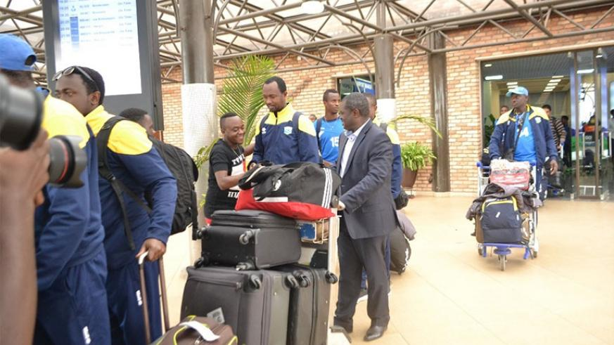 Amavubi assistant coach Vincent Mashami and the Director of Sports in the Ministry of Sports and Culture on arrival Kigali International Airport last Friday and there was no one to....