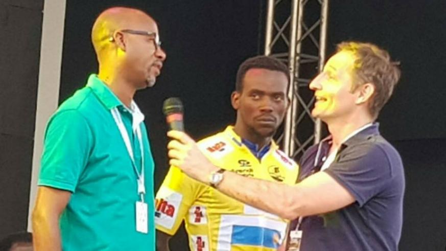 Rwanda Cycling Federation president, Aimable Bayingana being interviewed as Yellow Jersey winner Joseph Areruya looks on in Cameroon yesterday. / Courtesy