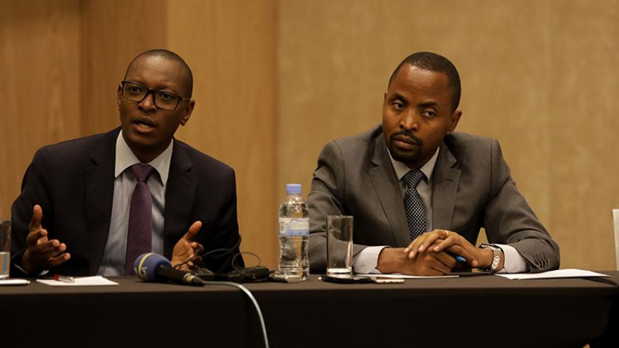 Patrick Nyirishema, the director general of Rwanda Utilities Regulatory Authority, speaks as Jean de Dieu Rurangirwa, the minister for information technology and communication look....