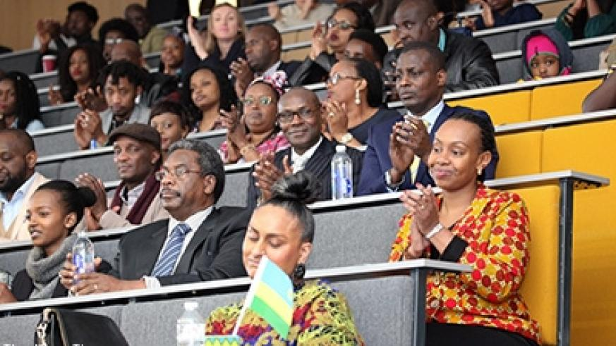 High Commissioner Karitanyi (R) and other participants applaud the performers. Courtesy.