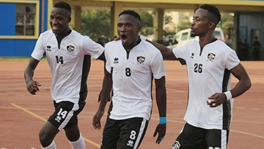 Djihad Bizimana (c) celebrates with his teammates Rugue Byiringiro (#14) and Issa Bigirimana as APR thumped Anse Réunion in Kigali yesterday. Samuel Ngenadahimana.