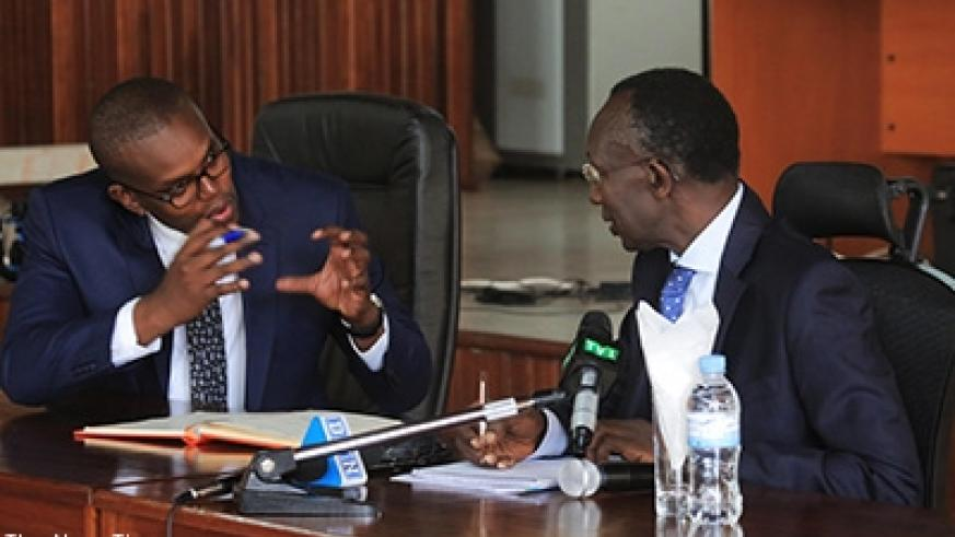 Chief Justice Sam Rugege (R) chats with Prosecutor General Jean Bosco Mutangana at the news conference. Sam Ngendahimana.