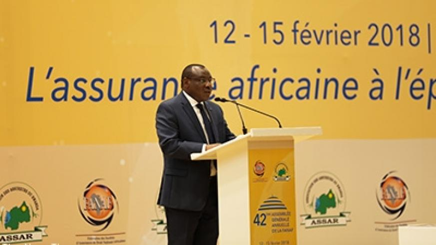 Finance minister Claver Gatete delivers his remarks at the 42nd General Assembly of the Federation of African National Insurance Companies in Kigali yesterday. Timothy Kisambira.