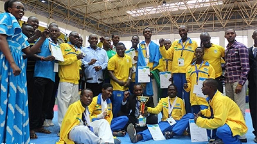 Rwandan players and staff pose for a group photo last year after clinching the best team of the tournament award and certificates. R. Bishumba